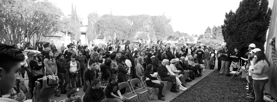 black and white photo of audience at mural event