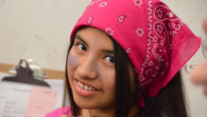 girl in costume wearing a pink bandana
